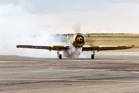 avia show 25.09.2016 Moldova. International Moldavian airport air show on the occasion of national day of Civil Aviation. aircraft landed for the spectators greeting blowing decorative  smoke