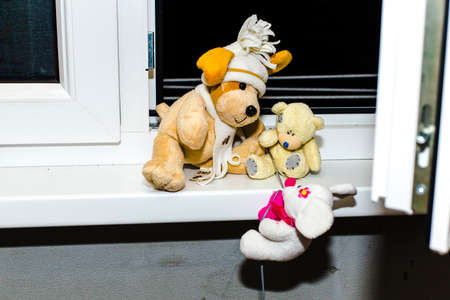 plush toys: conceptual photography, escape plush toys from home, 3 toys climb on the wire to the window.