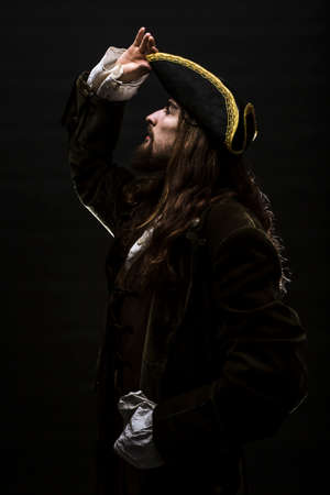 Portrait of a medieval bearded pirate on black background. 免版税图像 - 66328249