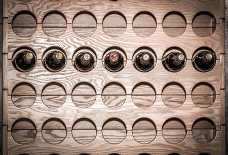 wall mounted: A wall mounted round wine rack in cellar