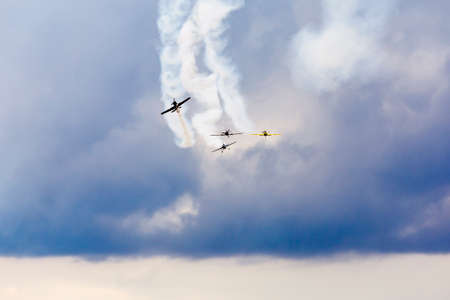 air show, small planes allowed smoke in the air showing the air acrobatics Stock Photo