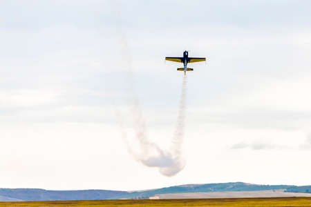 air show, small plane allowed smoke showing the air acrobatics above the ground