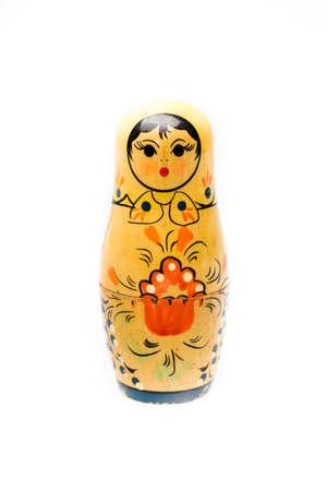 matryoshkas: Russian nesting dolls. Babushkas or matryoshkas isolated on white background, shallow DOF.