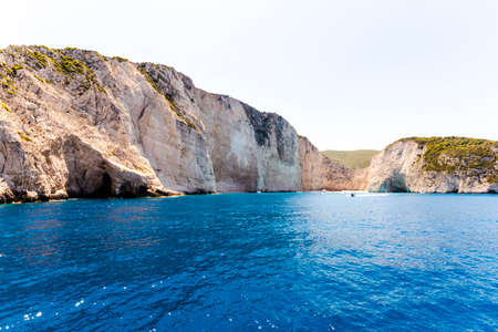 swimm: Amazing landscape of Navagio beach with shipwreck on Zakynthos island, view from the cruise ship. Greece.