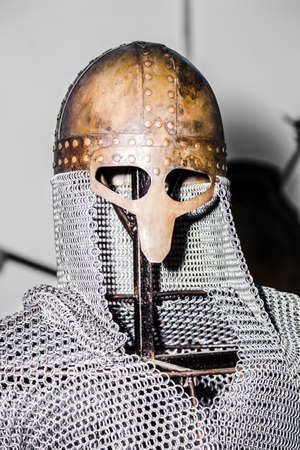 chain mail and helmet on the exhibition on the iron structure