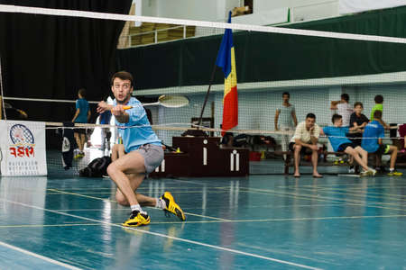 6 june 2015 an unidentified guy  tries to beat off the shuttlecock behind the grid in gym, Chisinau, Moldova