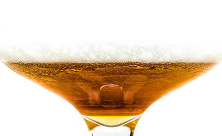 a large glass of beer with foam, closeup