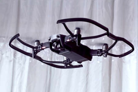 drone dji mavic air, quadroopter flies in the room, with protective accessories on it Editorial