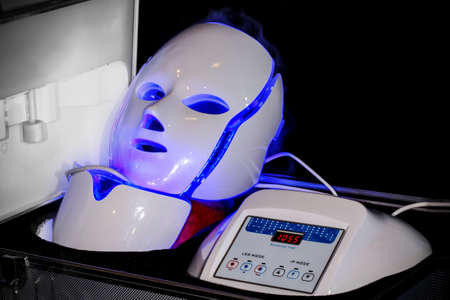 cosmetology led masks in a suitcase, light rejuvenating mask for facial skin therapy Фото со стока
