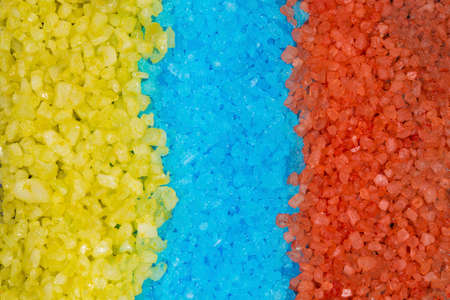 blue, yellow, and orange bath salts, background image Standard-Bild