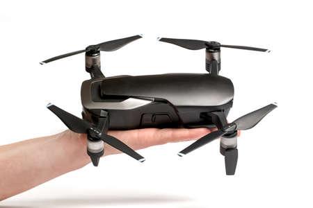 drone dji mavic air on palm, on white background