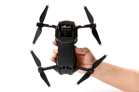 drone dji mavic air in hand, on a white background, the underside Editorial