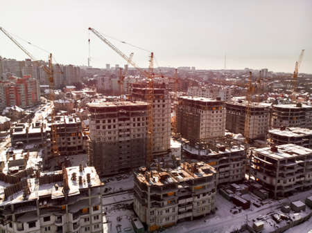 construction of a residential complex, air filming, toned, background image on a winter day