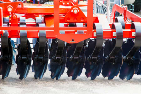 New, black harrows for plowing fields, background photo