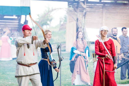 26 june 2015 historical reconstruction, unidentified people in clothes and headgear of past centuries. The weapon of soldiers is ancient, Vatra, Moldova