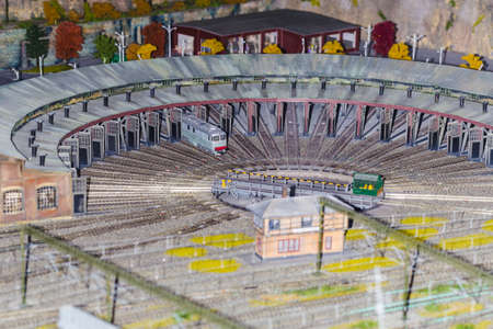 the only train stands in the depot layout, the background image, reduced model Banco de Imagens