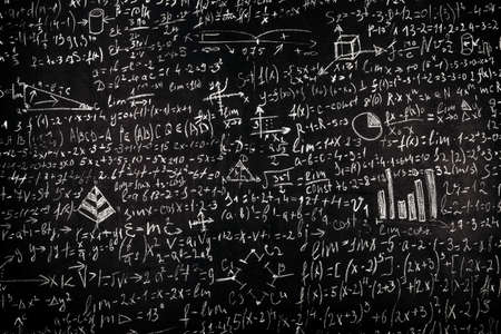 Blackboard inscribed with scientific formulas and calculations in physics and mathematics, background image Stock Photo