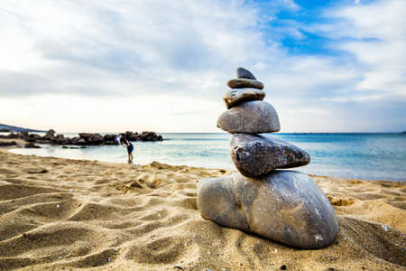 Stone cairn at the beach, concept of balance