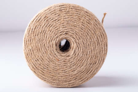 Natural jute rope, isolated on white background