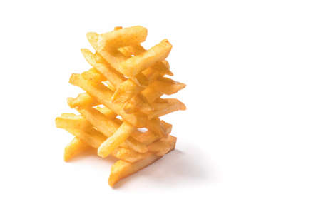 appetizing french fries in the form of pyramids on a white background Stock Photo