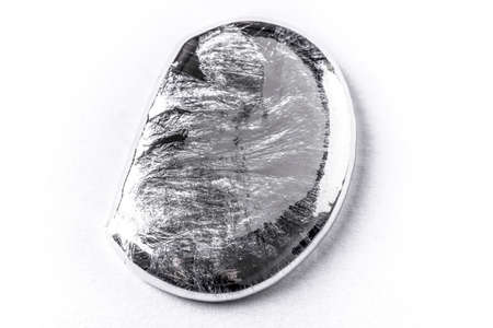 Liquid metal drop on white background
