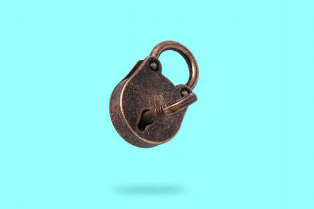 levitating closed bronze lock with key on azure background