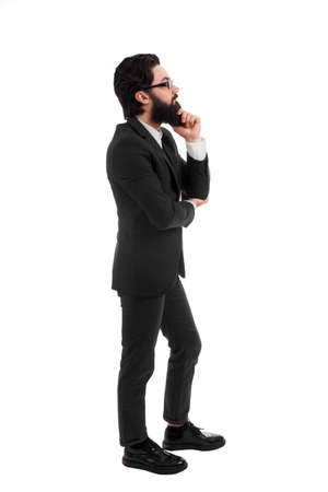 full length portrait of  thinking bearded businessman, isolated on white background