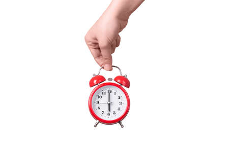 red alarm clock in hand, isolated on white background, concept time to wake up Banco de Imagens