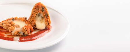 Arancini fried rice balls on white background, panoramic image, typical sicilian street food