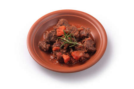 Goulash, beef stew with carrot, isolated on white background.