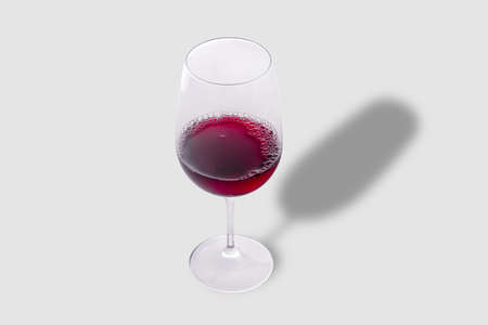 Glass of red wine on gray background Imagens