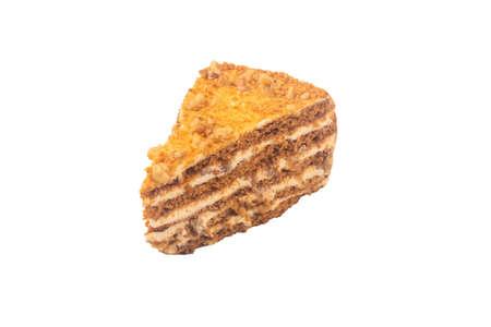 Slice of layered honey cake isolated on white background Imagens