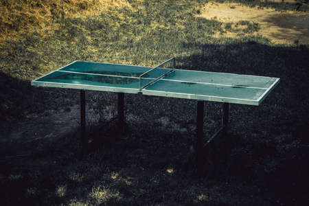 Outdoors abandoned ping pong table, toned image