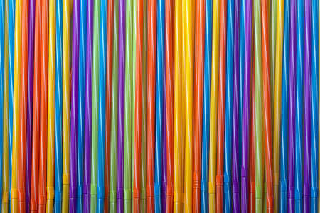 background of colorful cocktail tubes, straw for drinks, concept accessories to celebrate your party