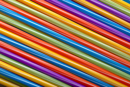 colored cocktail tubes background image, concept accessories to celebrate your party Фото со стока