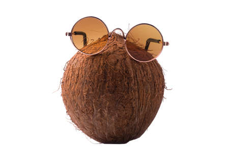Coconut with sunglasses, concept art of summer and vacation, coconut isolated on white background