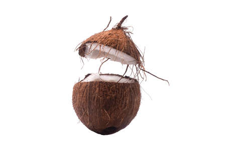 Two coconut section halves isolated on white background one broken in two 写真素材