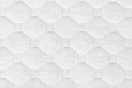Background of soft comfortable quilted white pillow