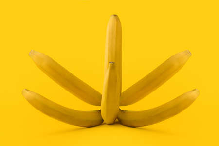 Bunch of bananas on yellow background. Healthy food concept