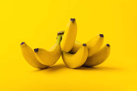 Bunch of bananas on yellow background. Healthy food concept 写真素材 - 131513835
