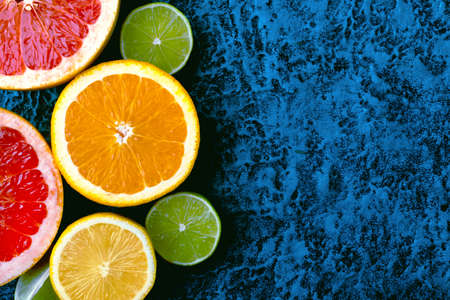 Citrus fruits collection, food background oranges, lemons, limes and grapefruit fresh fruits background with space for text.