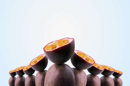 group of half sliced passion fruits balancing on whole passion fruits on blue background