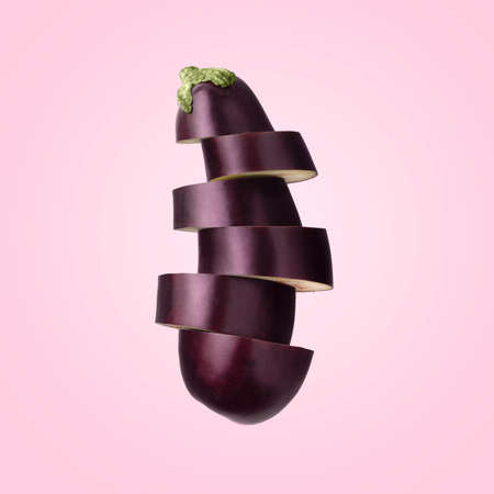 Sliced eggplant on pink background. 写真素材