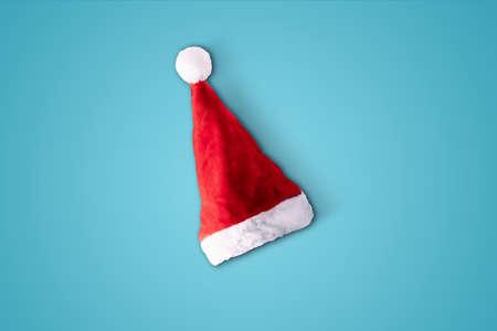 classic red santa cap over blue background
