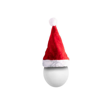 egg in santa hat isolated on white background, merry christmas concept