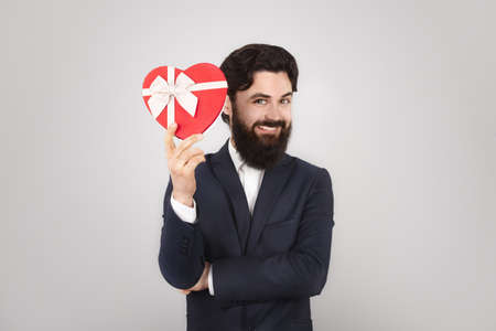 Happy Valentine Day, man holding present in shape of heart, 14 February Holiday Concept Zdjęcie Seryjne