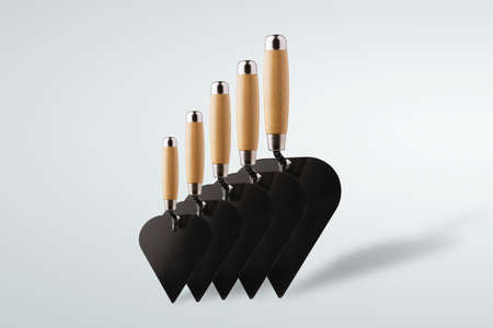 set of construction spatulas over gray background