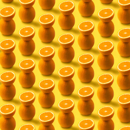 orange fruit pattern on yellow background, creative summer concept Zdjęcie Seryjne