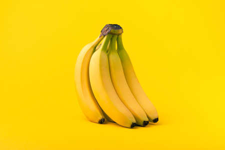 Bunch of bananas on yellow background, Healthy food concept