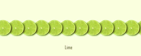 sliced green lime over yellow background, panoramic image